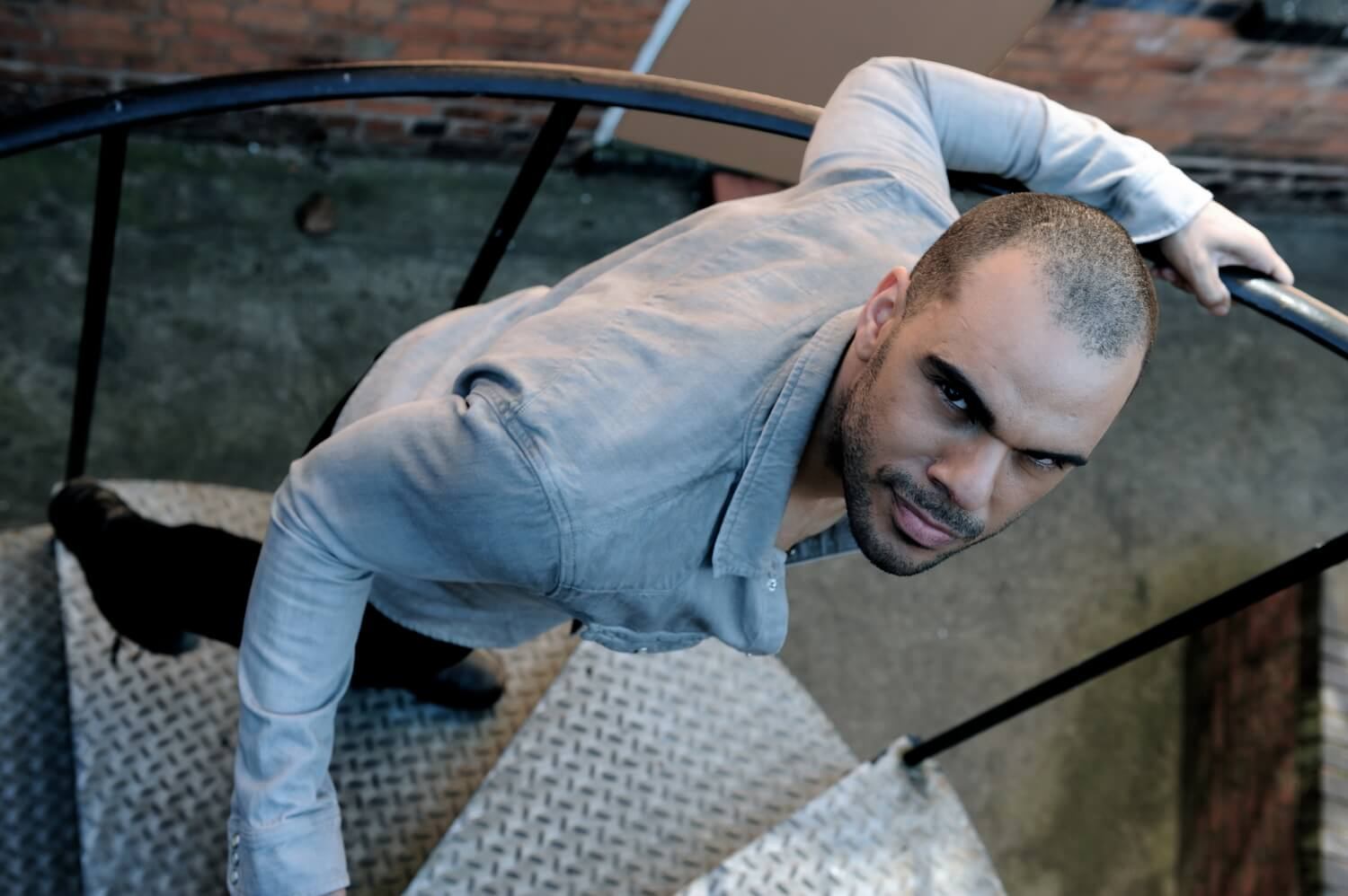 Professional male model portfolio photographer, vibrant, edgy studio and location photo shoot, stylish shots in a cool, urban environment, strong photography in Birmingham
