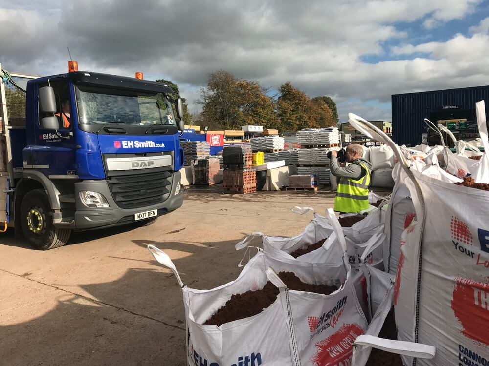 Bags of style - using the sandbags to both frame the shot and establish the branding of EH Smith - builders merchants - who use Ryder trucks to supply vehicles