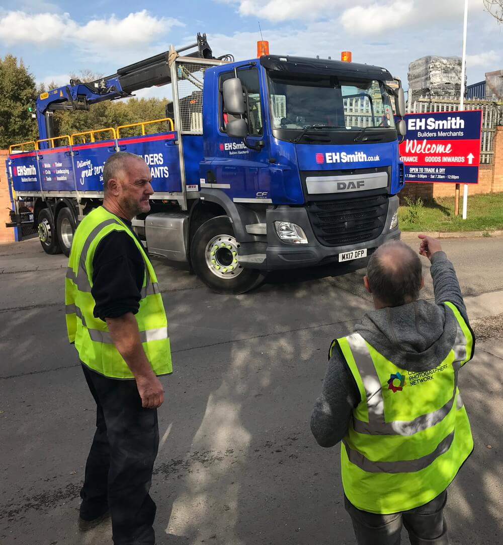 Graham chats to the vehicle driver to direct where the vehicle needs to be shot