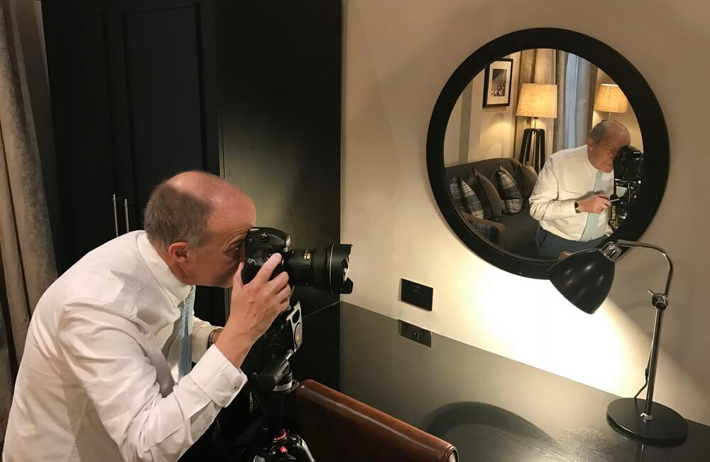 Reflection - o is for oakesstudios - photographer in the circular mirror of this top hotel destination rooms.